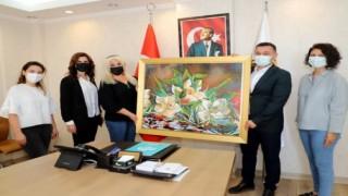 Ahmet bebeğe yardım için satılan tabloyu Başkan Yücel aldı